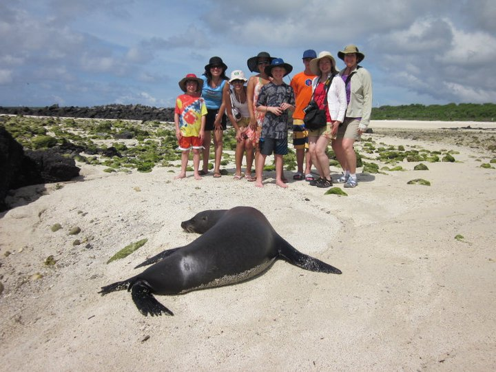 Sea lion and our group including staff member, Marita Nuñez